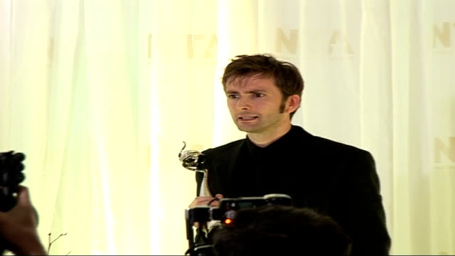 Red carpet arrivals and interviews / Winners room photocalls and interviews David Tennant along to stage and posing with award for photocall David...