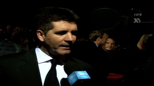 Red carpet arrivals and interviews / Winners room photocalls and interviews Sinitta and Cowell speaking to press SOT Chris Fountain interview on red...