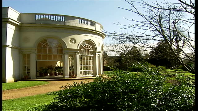 vídeos y material grabado en eventos de stock de national trust property osterley park; england: london: hounslow: osterley park: ext sun in sky tilt down lake mallard duck on water pathway with... - bare tree