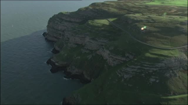 national trust purchases part of great orme head; wales: llandudno: great orme: ext air views / aerials great orme headland - national trust video stock e b–roll