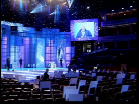 London Royal Albert Hall Preparations underway for National TV Awards ceremony PAN MS Sir Trevor McDonald on stage in casual clothes MS Cardboard...