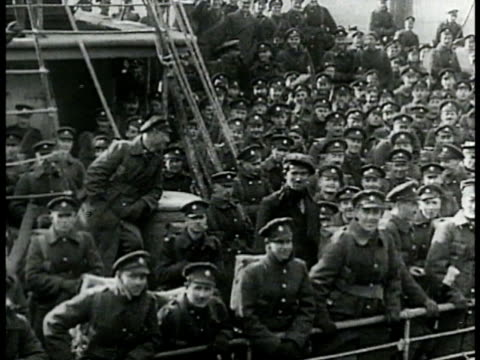 national war memorial confederation square. mot 1914: canadian soldiers in coats on crowded ship deck some waving . troops in coats marching in... - 1914 stock videos & royalty-free footage