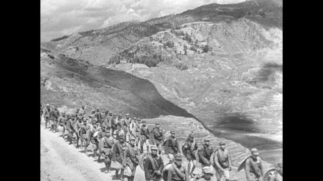 china nationalist chinese soldiers walking on mountain road cu chinese soldiers feet shoes falling apart on feet chinese military political leader... - chiang kai shek stock-videos und b-roll-filmmaterial