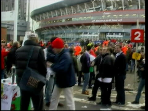 England beat Wales and Ireland beat Italy WALES Cardiff Millennium Stadium EXT GV Fans about outside stadium TILT UP exterior of Millennium Stadium...