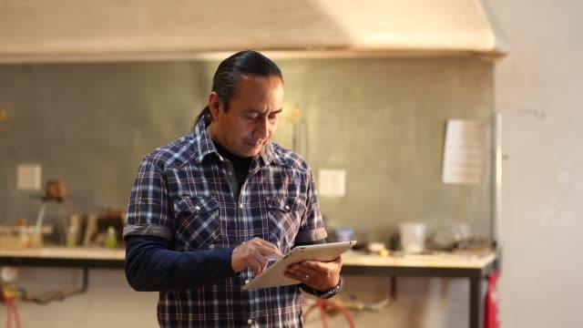 native american artist using digital tablet in his art studio - using digital tablet stock videos & royalty-free footage