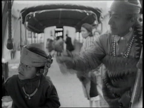 1928 montage native american family inspecting airplane / united states - 1928 stock videos & royalty-free footage