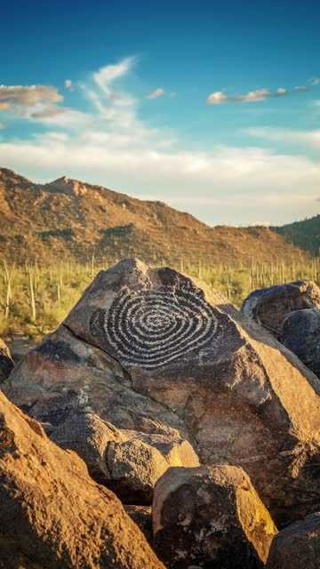 native american indian spiral petroglyph at signal hill in saguaro national park, arizona, vertical video, slow zoom in - cactus drawing stock videos & royalty-free footage
