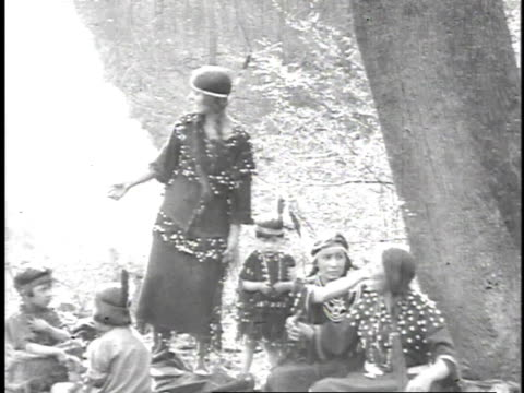 1923 reenactment native american indian woman and man offer bowl of oil to missionary and puts in his hand / united states - indigenous peoples of the americas stock videos & royalty-free footage