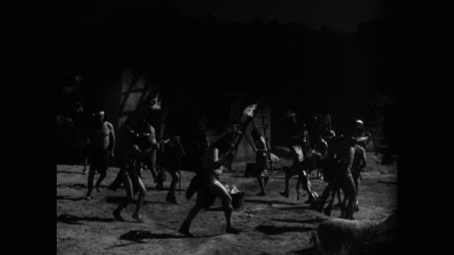 vídeos y material grabado en eventos de stock de native american people dancing around bonfire - western usa