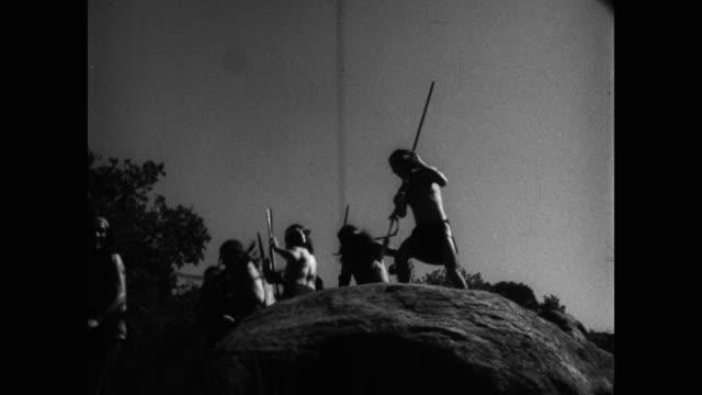 vídeos y material grabado en eventos de stock de native american people running with spears - western usa