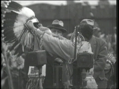 a native american puts a traditional headdress on new york governor alfred e smith during a namegiving ceremony - headdress stock videos and b-roll footage