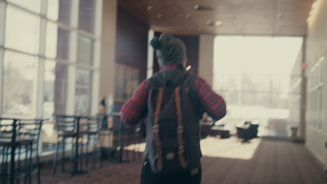 native american student walking into university building - rucksack stock videos and b-roll footage