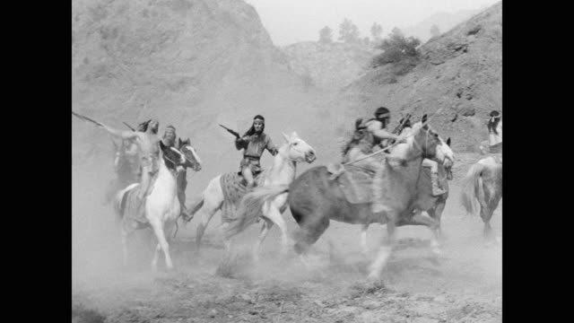 native american warriors with weapons riding horses in canyon, usa - war stock videos & royalty-free footage
