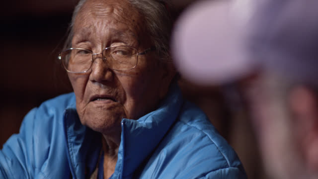 a native american woman (navajo) in her eighties nods her head while talking to someone - native american ethnicity stock videos & royalty-free footage