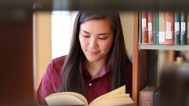 native american woman student studying in college library - indigenous peoples of the americas stock videos & royalty-free footage