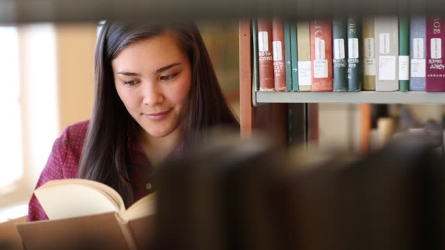 Native American woman student studying in college library