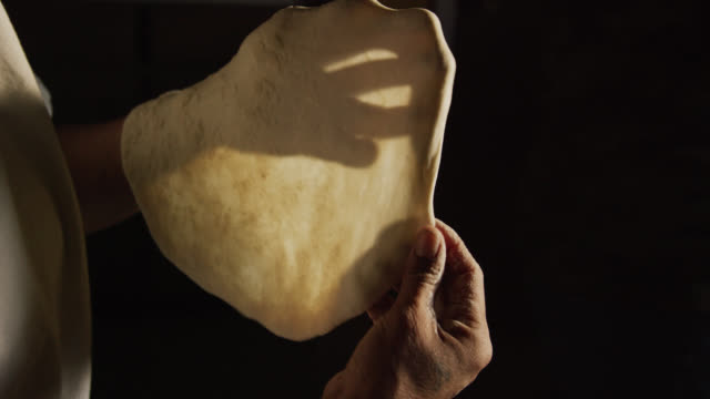 a native american (navajo) woman's hands form a tortilla (fry bread) before placing it into a pan of oil on a stovetop in a kitchen - tortilla flatbread stock videos & royalty-free footage