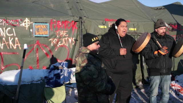 native americans from washington state sing and drum at oceti sakowin camp near the standing rock sioux reservation on december 4 2016 outside cannon... - pipeline stock videos and b-roll footage