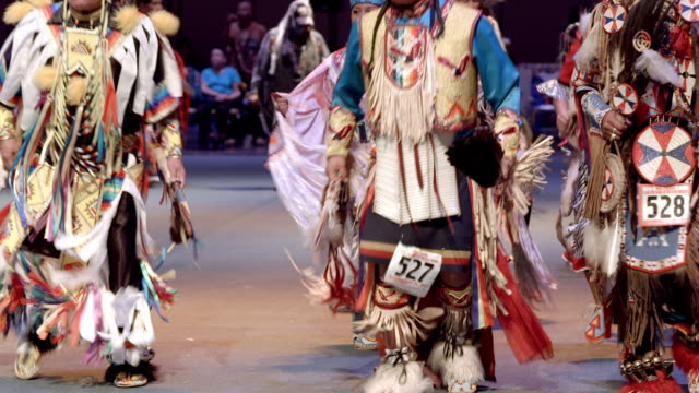 native americans show off their dancing and singing skills through traditional competition at annual indio powwow / indio, california, usa - tribù del nord america video stock e b–roll