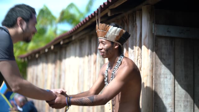 native brazilian welcoming the tourist on brazilian indigenous tribe, from guarani ethnicity - respect stock videos & royalty-free footage