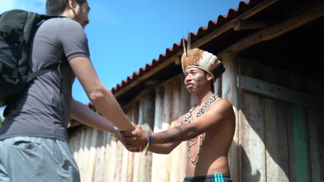 native brazilian welcoming the tourist on brazilian indigenous tribe, from guarani ethnicity - tourist stock videos & royalty-free footage