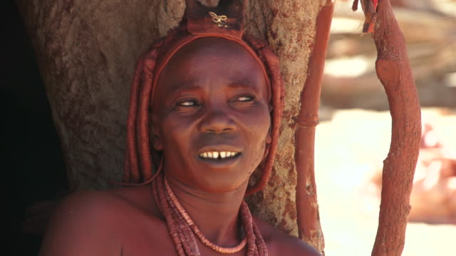 cu native himba woman smiling and laughing / himba, kunene, namibia - wiese video stock e b–roll