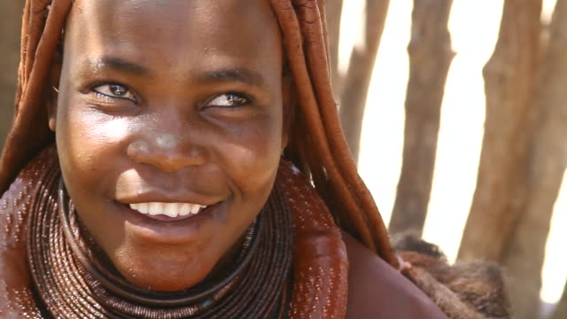 CU Native himba woman smiling / Himba, Kunene, Namibia