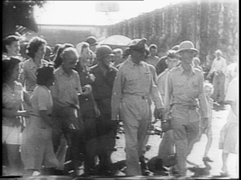 native japanese collaborators are captured / allied troops escort the prisoners / prisoners against wall raise their hands in surrender / general... - japanese surrender stock videos & royalty-free footage