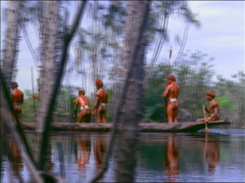 native men standing in canoe on river passing camera / amazonas, brazil - amazonas state brazil stock videos and b-roll footage