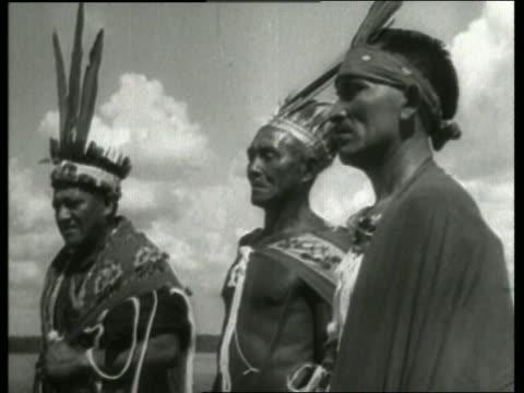 vidéos et rushes de b/w 3 native men with headdresses / dutch guiana / / no - coiffe traditionnelle