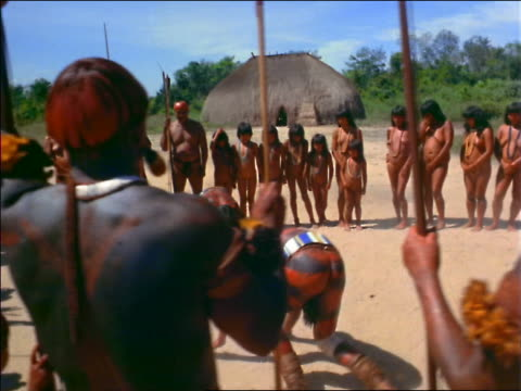 2 native men wrestling as tribe looks on / amazonas, brazil - cinematografi bildbanksvideor och videomaterial från bakom kulisserna