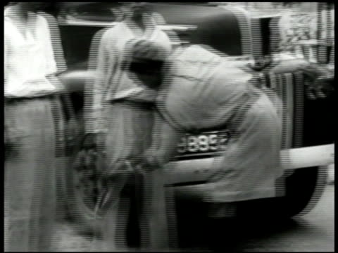 native south east asian soldiers performing search patting down of two men by truck gunners in sandbag barricade. soldier inspecting driver's seat of... - barricade stock videos & royalty-free footage