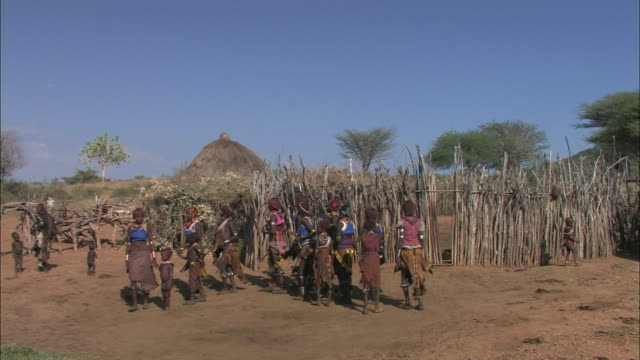 native women and children dance in a tight circle. - ethiopia stock videos & royalty-free footage