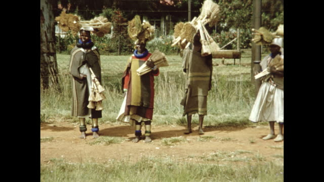 natives in south africa pose for photos. a driver tips them. - film montage stock videos & royalty-free footage
