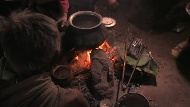 natives sit on the floor of their hut and cook. - hut stock videos & royalty-free footage