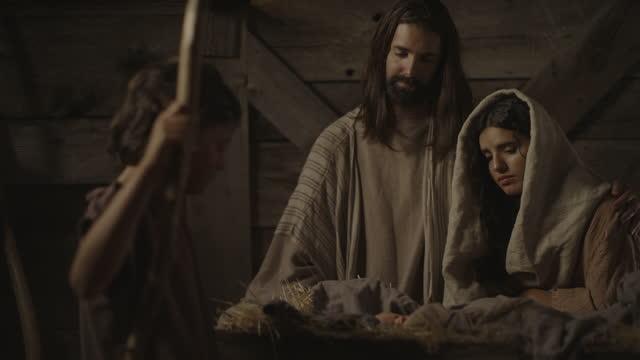nativity scene of joseph welcoming shepherd to visit baby jesus and mary / cedar hills, utah, united states - genderblend stock videos & royalty-free footage