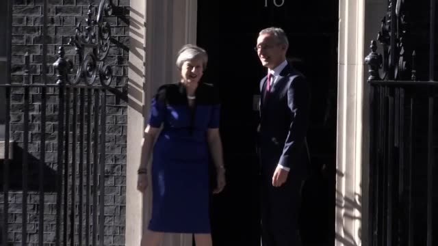 Nato Secretary General Jens Stoltenberg is greeted by Theresa May at Downing Street