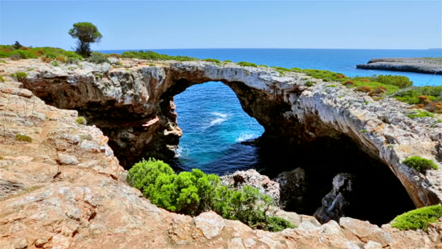 Natural arch / bridge near by Cala Varques on east coast on Spanish Balearic island of Majorca / Spain