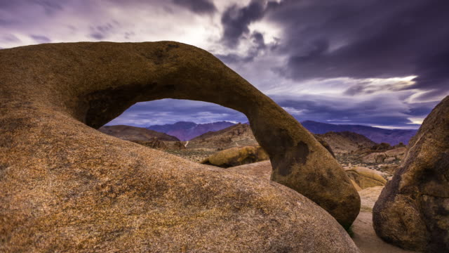 Natural Arch in California Desert - Dawn to Day Time Lapse