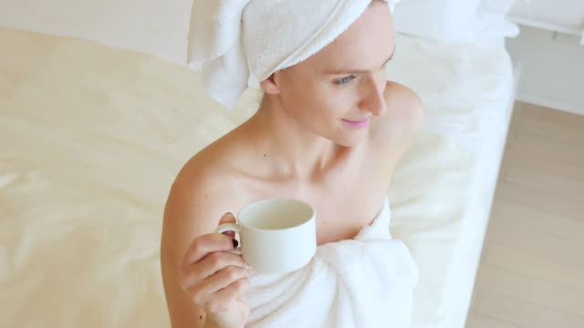 natural beauty with cup of tea - wrapped in a towel stock videos & royalty-free footage