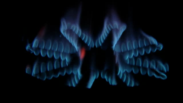 natural gas flame in the dark - hob stock videos & royalty-free footage