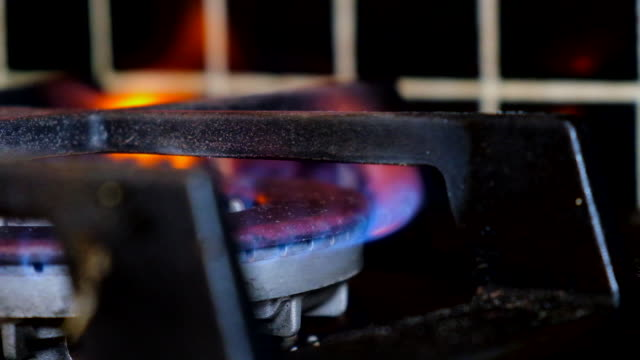 natural gas lighting on cooktop - industrie ofen stock-videos und b-roll-filmmaterial
