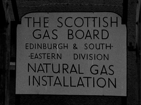 natural gas switched on in scotland scotland lothian cousland gas holder pan to natural gas installation unit / cu notice which describes the unit /... - valve stock videos & royalty-free footage