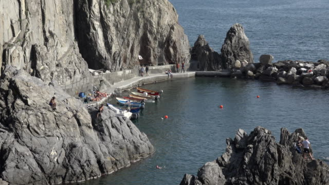 Natural harbor of Manarola with rock formation