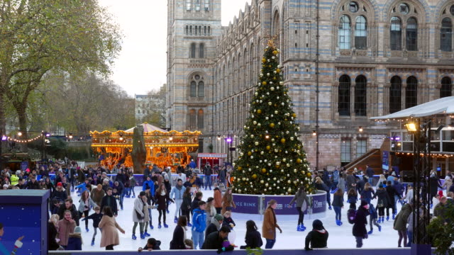 natural history museum xmas ice rink - ice rink stock videos & royalty-free footage