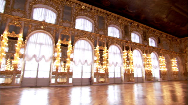 natural light floods through the windows of the great hall in catherine palace. - arch stock videos & royalty-free footage