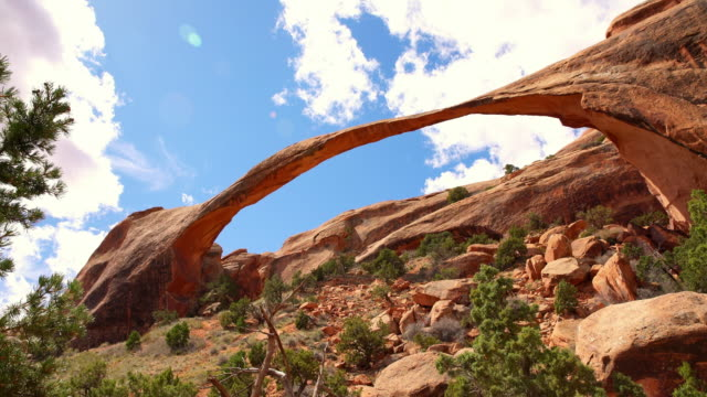 ds natural sandstone arch at the arches national park - natural arch stock videos & royalty-free footage