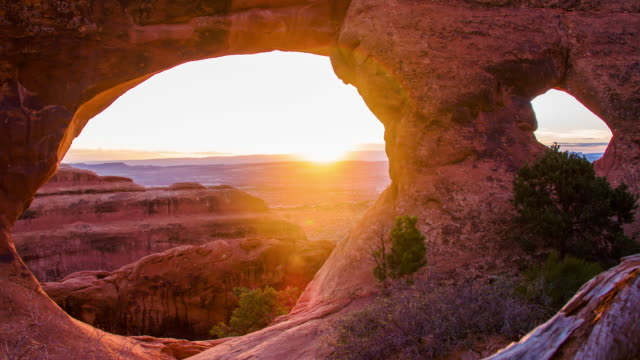 ds natural sandstone arch in the sunrise - moab utah stock videos and b-roll footage