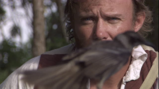naturalist charles darwin observes mockingbirds in the galapagos islands. available in hd. - チャールズ・ダーウィン点の映像素材/bロール