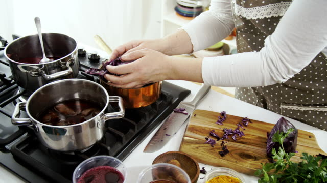 naturally dye for coloring easter eggs - red cabbage stock videos & royalty-free footage